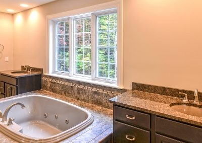 two custom vanities with bathtub between them
