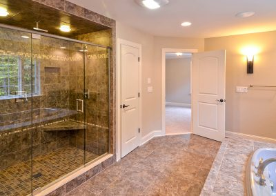 large walk in shower with bathtub