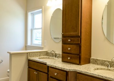 custom double vanity with upper cabinet
