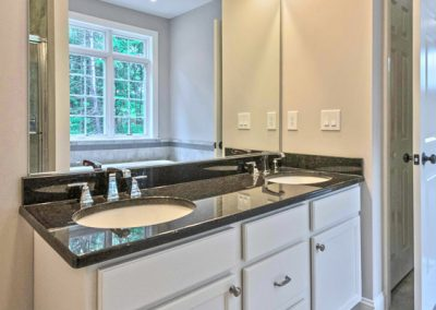 white double vanity with large mirror