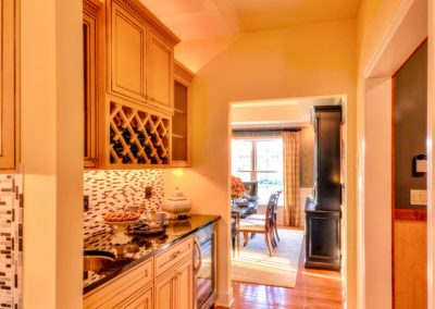 built in butlers pantry with wet bar and wine rack