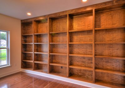 custom built in shelving in the study
