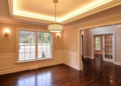 dining room with illuminated tray ceiling