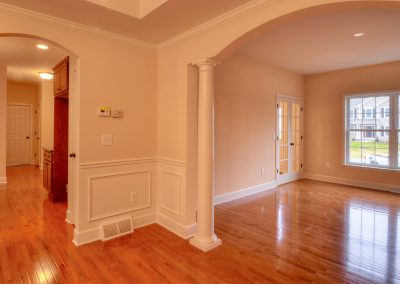 dining room with arched openings and wall molding