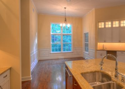 dining area with wet bar and wall molding