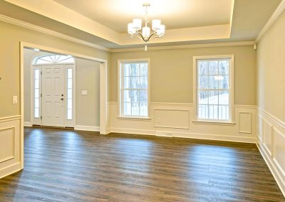 dining room with windows and tray ceiling