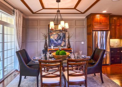 furnished dining area with decorative ceiling and wall