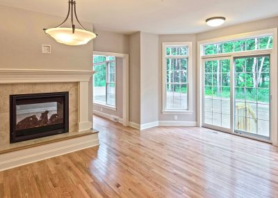 dining room with fireplace and bay window with sliding door