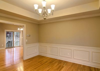 dining room with wall molding and tray ceiling