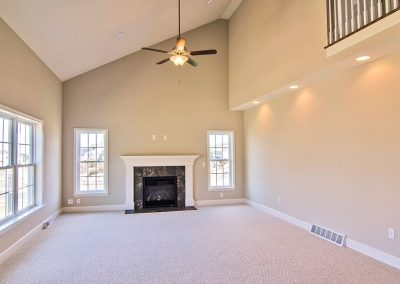 vaulted ceiling and fireplace in family room