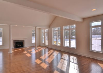 custom extended family room with lots of windows and fireplace
