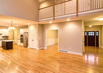 upper floor balcony overlooking two story family room