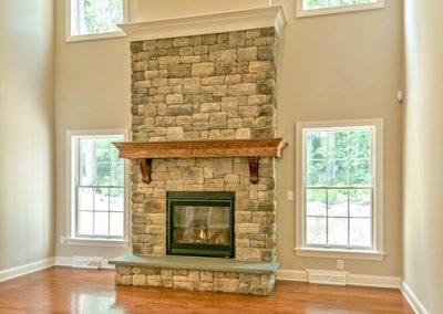 custom two story stone fireplace