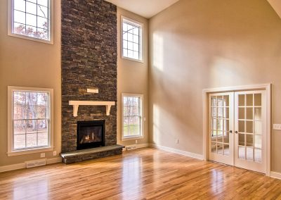 two story stone fireplace and double french doors