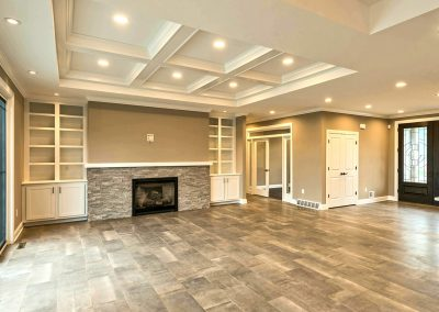 custom family room with coffered ceiling