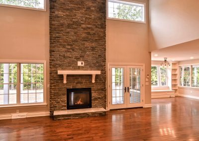 two story stone fireplace with double french doors