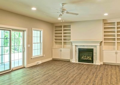 hardwood family room with fireplace and custom built ins