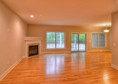 open plan family room with hardwood and corner fireplace