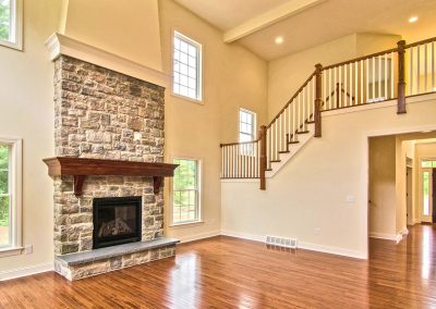 custom stone fireplace and balcony staircase