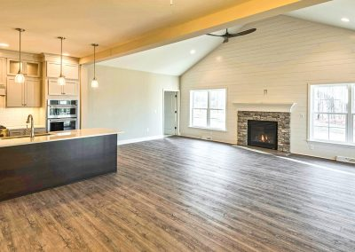 open plan kitchen and family room with fireplace