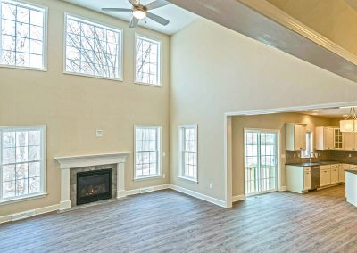 two story family room with hardwood