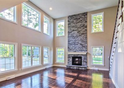 two story stone fireplace and staircase