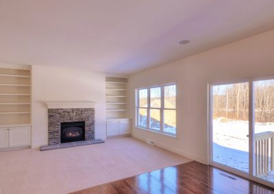 custom shelving and fireplace in family room