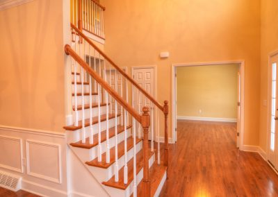 staircase with wall from foyer