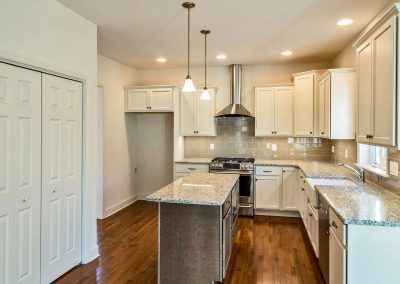 white kitchen cabinets in the cypress 1 single family home